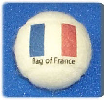 tennis balls branded  with French Flag