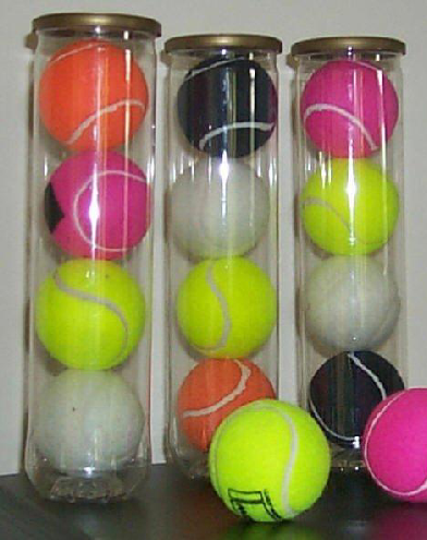 mixed colours of tennis balls in tubes